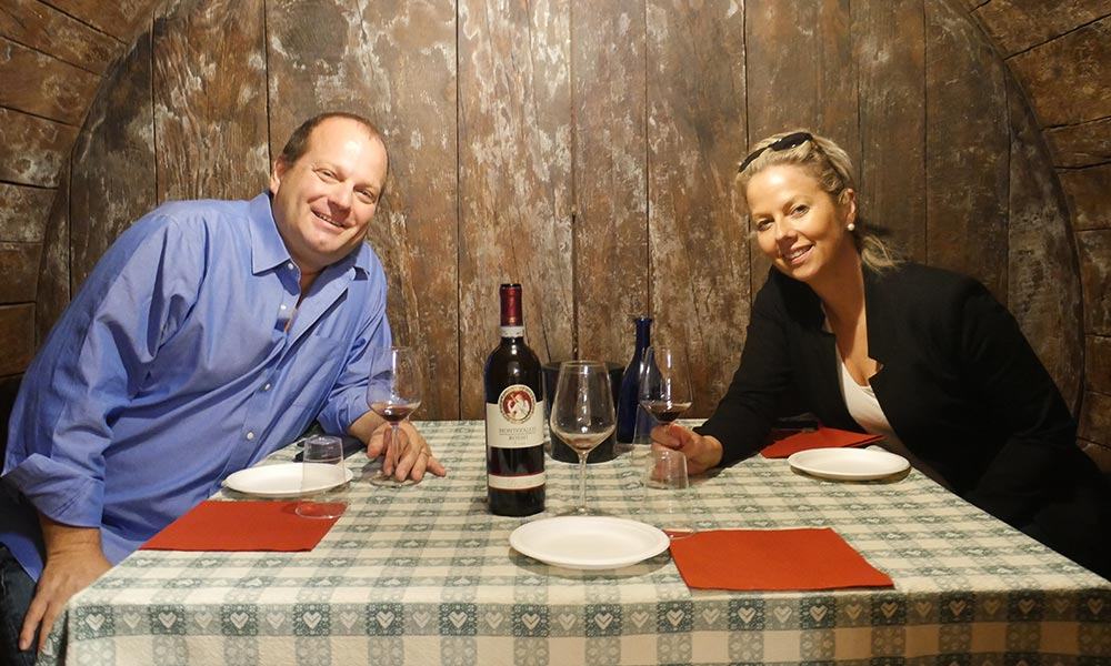 Couple enjoying Montefalco wine on Umbrian wine tour