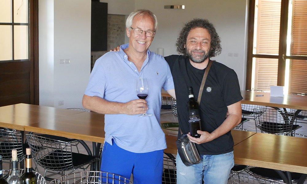 men enjoying a glass of Umrian wine